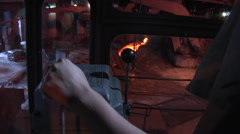 Stock Video Footage of Crane Driver Woman's Hand on the Lever Moving Crane Blast Furnace through the