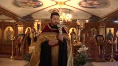 The Priest Spends a Sacred Ritual in the Church Stock Footage