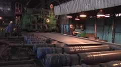 Three Workers Men And Senior Aged Woman Are Sanding at Metal Rolling Machine Stock Footage
