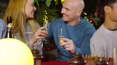 Happy attractive caucasian couple chatting over drinks at outdoor party Stock Footage