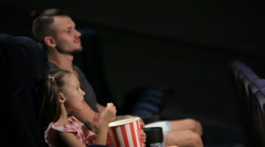 Elder brother and little sister are watching movie - stock footage