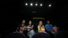 Group of friends wathing film in cinema Stock Footage