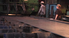 Man And Senior Aged Woman at The Machine Rolling Metal on a Rollers Workers Men - stock footage