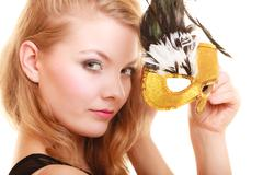Stock Photo of Masquerade. Beautiful girl in carnival mask