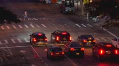 Street traffic cars night urban Manhattan New York City NYC high angle Stock Footage