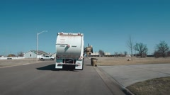 Garbage Truck Pick Up Rear View - Daytime Stock Footage