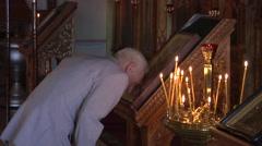 The Grey-Haired Old Man Prays Near an Altar Stock Footage