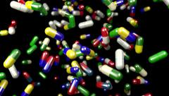 Pills drugs capsules falling slow motion closeup DOF 4K - stock footage