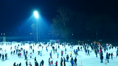 People iceskate in the Budapest City Park at night Stock Footage