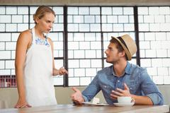 Stock Photo of Argument between a waitress and a client
