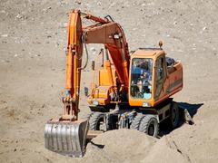 Excavator in action - stock photo