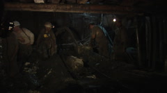 Stock Video Footage of Four Workers Miners Men is Safety Helmets And Lamps on a Helmets Respirators
