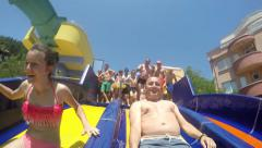 Family enjoyment on the water slide at Aqua Park, 120fps SLOW MOTION Stock Footage