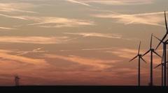 Wind Turbines Medium Shot Pan Right - Sunset.mp4 Stock Footage