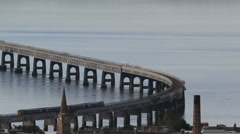 Elevated view of Train crossing Tay Rail Bridge Dundee Scotland Stock Footage