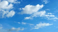 Blue daylight summer sky with fluffy white clouds as nature image. Time lapse - stock footage