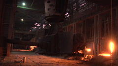 Worker is Passing By Machine is Loading The Coal Into The Blast Furnace Light Stock Footage