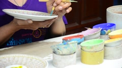 Painting ceramic benjarong is traditional thai five basic colors style pottery Stock Footage
