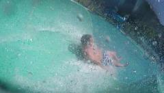 Guy Sliding Down a Open Water Slide Tube, SUPER SLOW MOTION Stock Footage