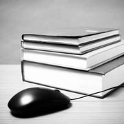 Book and computer mouse black and white color tone style Stock Photos