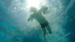 Boy jumping and diving in Swimming Pool. For videos about: swimming, pools, s Stock Footage