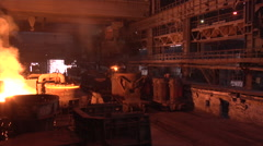 Boiling Metal in The Steel Vessel Orange Light Wagons are Transporting Ore Stock Footage