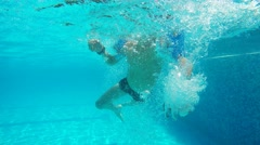 Boy learn to swim in Swimming Pool For videos about: swimming, pools, summer Stock Footage