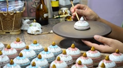Painting ceramic benjarong is traditional thai five basic colors style potC 0262 Stock Footage