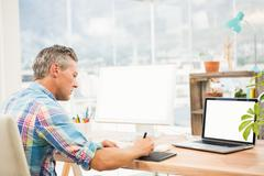 Casual designer working with digitizer - stock photo