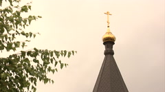 Stock Video Footage of Spire and Small Golden Cupola with Cross White Buildings of a Temple Church at