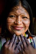 Unknown indigenous woman during a ritual in the amazon rainforest - stock photo