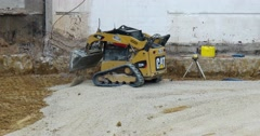 Skid Steer Loader Moving Gravel - 4k Stock Footage