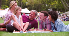 Family and friends sitting at outdoor event Stock Footage