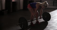 Young women lifting bar bell in gym - stock footage