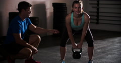 Young women training with kettle bell in gym Stock Footage