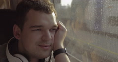 Man traveling by train and enjoying outside view - stock footage