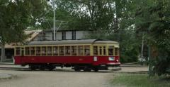Trolley crosses intersection at Fort Edmonton Stock Footage