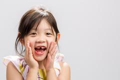 Cute Asian girl shouting out loud, studio isolated white background. - stock photo