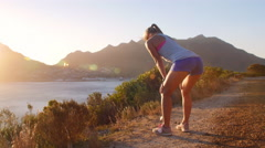 Women admiring a coastal view after jogging Stock Footage