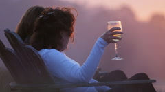 WOMEN AT LAKE AT SUNSET WITH WINE SLO-MO - stock footage