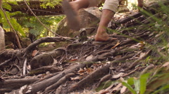 Low angle view of friends walking along forest path - stock footage