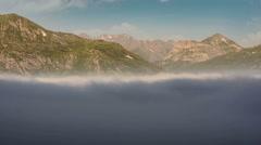 Fog over Mont Cenis lake summer alpine landscape time lapse 4K Stock Footage