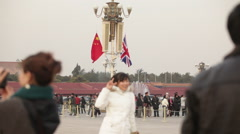 Chinese girl, British flag, Tiananmen Square Stock Footage