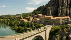 Bridge and traffic bellow Rocher de Baume in Sisteron southern France time lapse Stock Footage