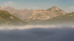 Clouds below mountain peaks Lac du Mont Cenis artificial lake Stock Footage