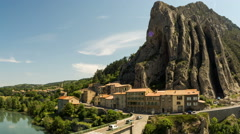 Sisteron village bridge and Rocher de la Baume rock traffic time lapse Stock Footage