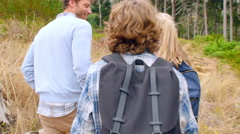 Couple walking in the countryside, back view Stock Footage