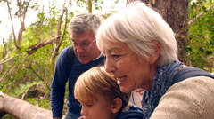 Multi generation family with teenage kids walking in nature - stock footage