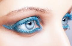 Close-up shot of female eyes blue make-up - stock photo