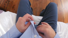 Point of view of man ironing shirt Stock Footage